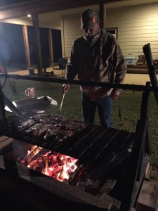 Mike cooking some steaks after the hunt